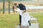 Beautiful husband and bride kiss — Stock Photo