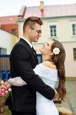 Husband and groom gaze at him — Stock Photo
