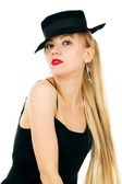 Photo of young woman in a black dress with the hat — Stock Photo