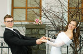 The husband and the bride hold hands each other — Stock Photo