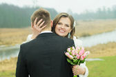The husband and the bride hug with each other — Stock Photo