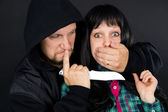 Man with a knife attacked girl — Stock Photo