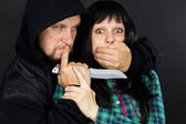 Violence, assault on a girl with a gun — Stock Photo