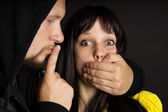 Violence, the offender threatened the victim — Stock Photo