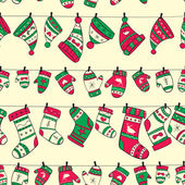 Winter seamless pattern with red green socks mittens and hats — Stock Vector