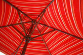 Striped Umbrella in Red — Stock Photo