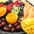 Variety of fresh fruit on plate — Foto Stock #24284795