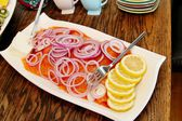 Plate of smoked salmon — Stock Photo