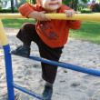 Stock Photo: Little boy plays in playground
