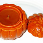 Orange candle in ceramic pumpkin — Stock Photo