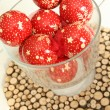 Christmas balls in glass vase — Stock Photo