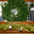 Fireplace mantel with wreath — Stock Photo #38677807