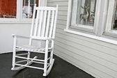 White rocking chair on porch — Stock Photo