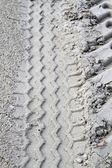 Closeup of tire tracks in sand — Stock Photo