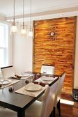 Modern dining room with back panel made in horizontal wood strips — Stock Photo