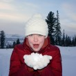 Girl is holding the white snow on the hands. — Stock Photo #16489809