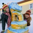 Girls near a snow sculpture. Close-up. — Stock Photo #18298631