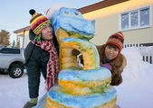 Girls near a snow sculpture. Close-up. — Stock Photo