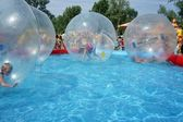 Children riding in a zorb balls. — Стоковое фото