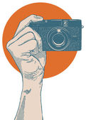 Hand holding small point and shoot camera — Stock Vector