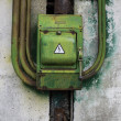 Old green rusty metal switch on beton wall — Stock Photo #30351993