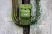 Old green rusty metal switch on beton wall — Stock Photo
