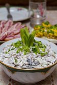 Salad of squid with mushrooms, garnished with chopped green onions on the festive table — Stock Photo