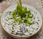 Salad of squid with mushrooms, garnished with chopped green onions — Stock Photo