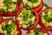 Tomatoes stuffed with cheese and mayonnaise and decorated with green onion closeup — Photo