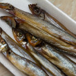 Smoked capelin on substrate — Stock Photo #41105993