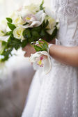 Orchid boutonniere for the bride's hand — Stock Photo