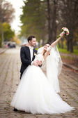 Married couple dance in the old road — Stock Photo