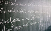 Blackboard with formulas and numbers — Stock Photo