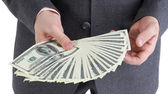 Stack banknotes of 100 dollars in male hands — Stock Photo