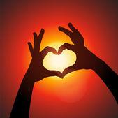 Love shape hands silhouette in sky — Stock Vector