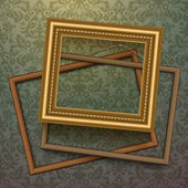 Vintage golden frames on floral background — Stockvector