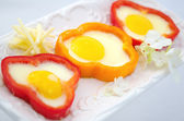 Fried eggs in sweet peppers — Stock Photo