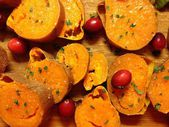 Baked sweet potato with cranberries, for Thanksgiving and New Year table, holiday food, family food — Stock Photo