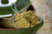 Italian pasta with basil and garlic — Stock Photo