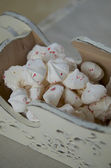 Meringues with peppermint candy crashes for Christmas dessert — Stock Photo