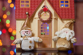 Santa Claus and Snowman against the beautiful house — Stock Photo