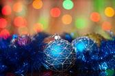 Christmas toys on a fir-tree — Stock Photo