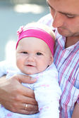 The baby on arms of the loving father — Stock Photo