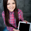 The young girl dreams and holds the touchpad — Stock Photo