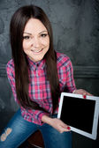 The young girl dreams and holds the touchpad — Stockfoto