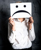 Holding a blank paper with sad face — Stock Photo