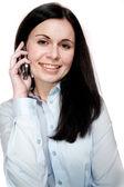 Ung kvinna talar via telefon — Stockfoto