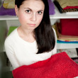 Young woman holds clean towels — Stock Photo
