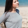 Beautiful brunette woman on the beach — Stock Photo