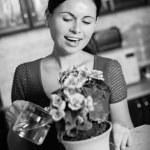 Woman arranging flowers — Stock Photo #39418771